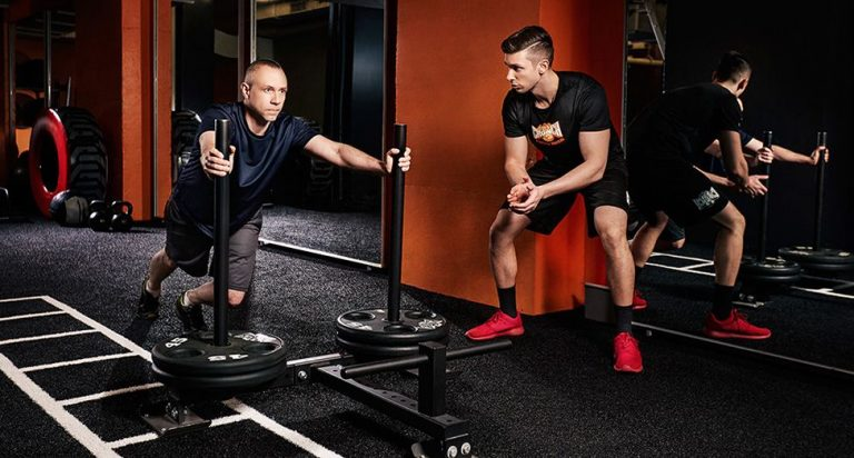 Why are personal trainers hired?